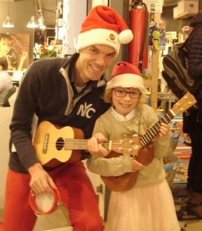 Vader en dochter op ukulele